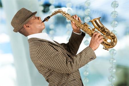 african sax: Man playing saxophone