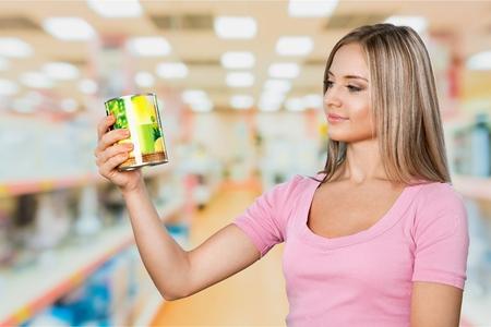 Woman buy grocery item in supermarket