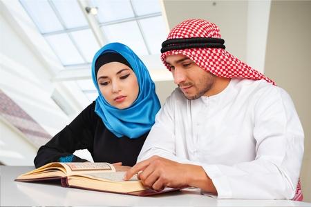 adults: Adults people reading Koran