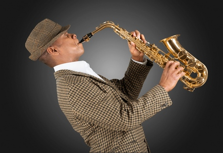 african sax: Adult playing saxophone