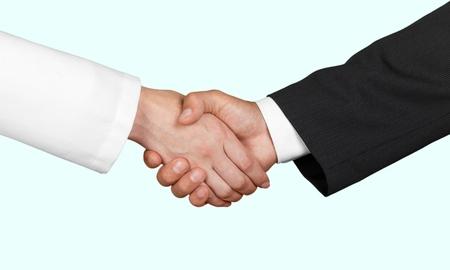 white coat: Handshake. Stock Photo