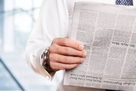 person reading: Newspaper. Stock Photo