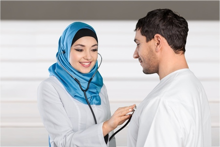auscultation: Arabic female doctor. Stock Photo