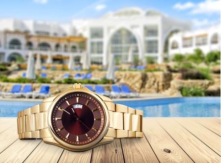 gold watch: Watch.