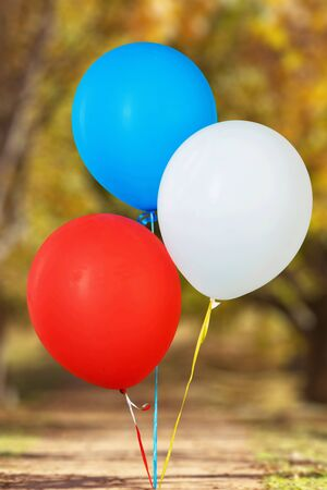 red white blue: Balloons.