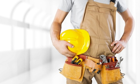 rolledup sleeves: Repairman. Stock Photo