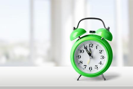 reminders: Green alarm clock.