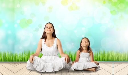 outdoor exercise: Yoga with child. Stock Photo