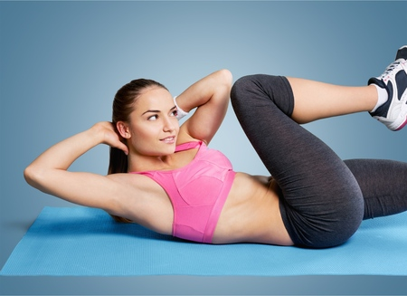 crunches: Woman crunches. Stock Photo
