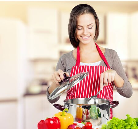 stereotypical: Cooking. Stock Photo