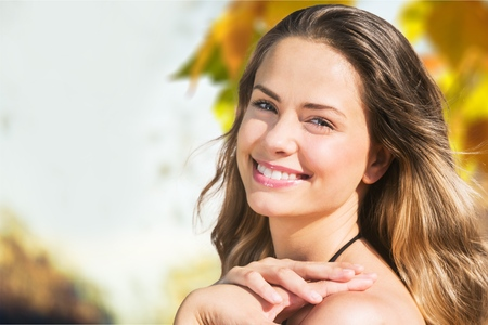 tan woman: Sun face. Stock Photo