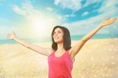 worshipping: Beach woman.
