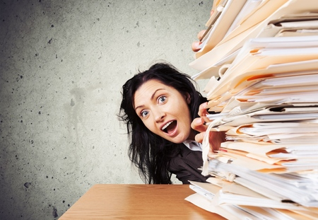 raise the white flag: Over-Burdened with Documents. Stock Photo