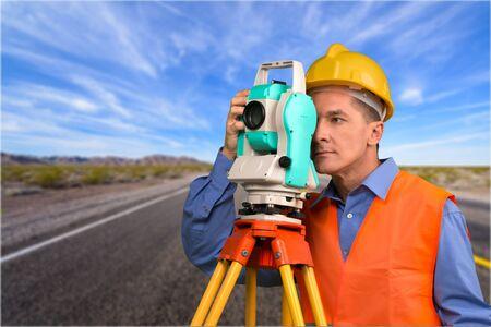looking through an object: Surveyor.