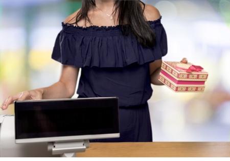 the clerk: Empleado de ventas. Foto de archivo