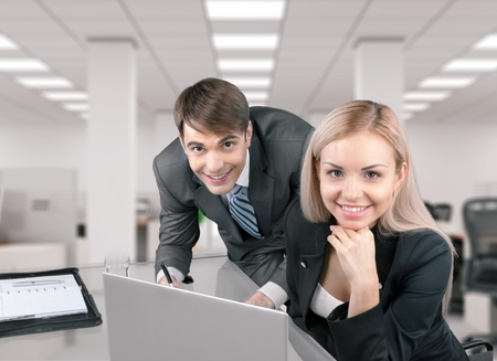 looking at computer: Office Workers. Stock Photo