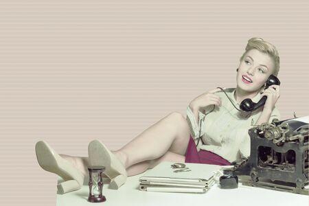 old fashioned rotary phone: Retro secretary.
