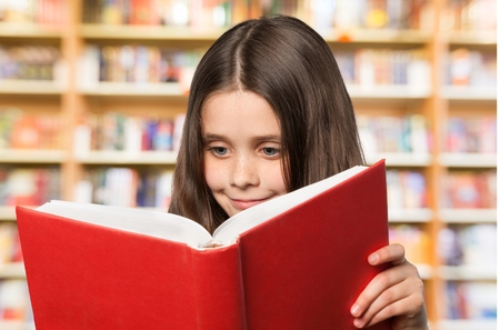 elementary age girls: Child Reading.