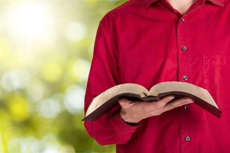person reading: Bible Reading.
