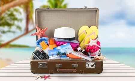 open suitcase: Summer suitcase.