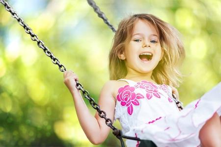 girl on swing: Child.