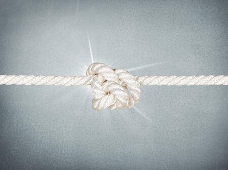 string together: Knot.