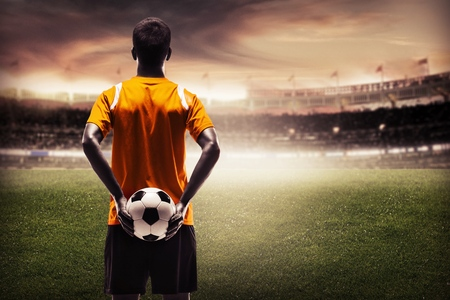 soccer player: Soccer player in shadow. Stock Photo