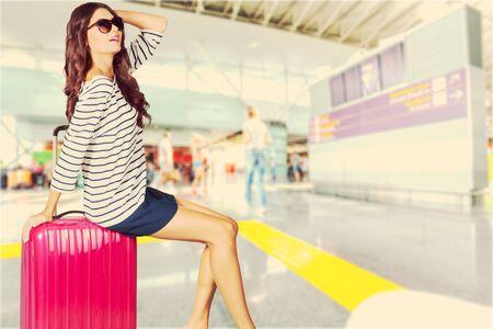 woman bag: woman sitting on traveling bag