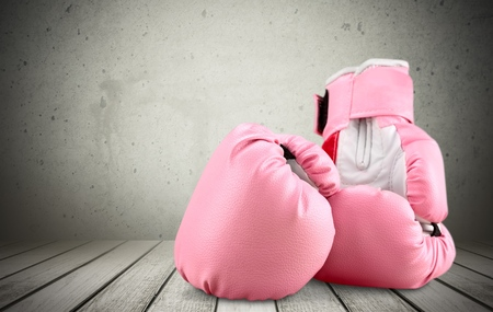 breast cancer: Pink boxing glove Stock Photo