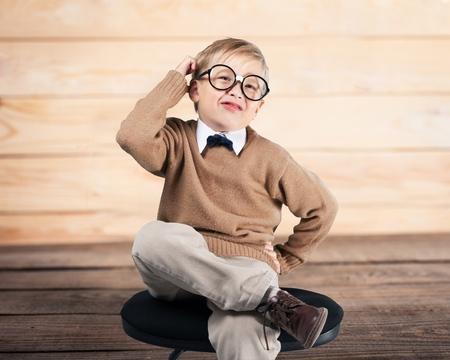 point of demand: Thinking kid. Stock Photo
