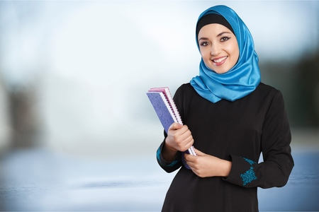female pose: Muslim female student. Stock Photo
