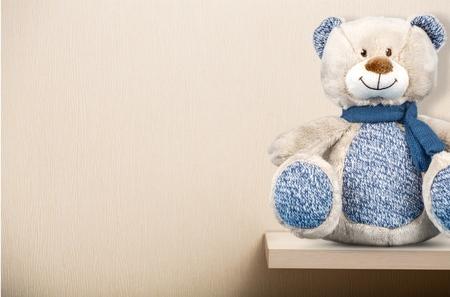 the shelf: Teddy bear on shelf. Stock Photo