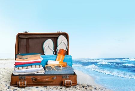 open suitcase: Open suitcase.