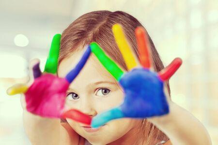 kids painted hands: School.