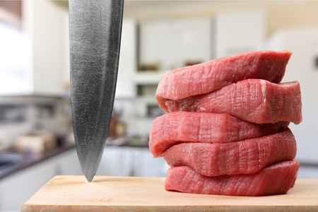 cutting meat: Meat.