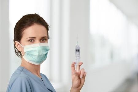 injection woman: Syringe. Stock Photo