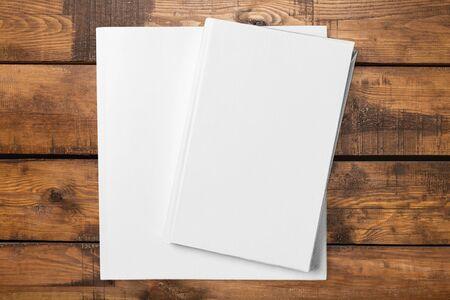 paper stack: Book.