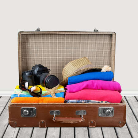 summer holiday: travel equipment on wooden background