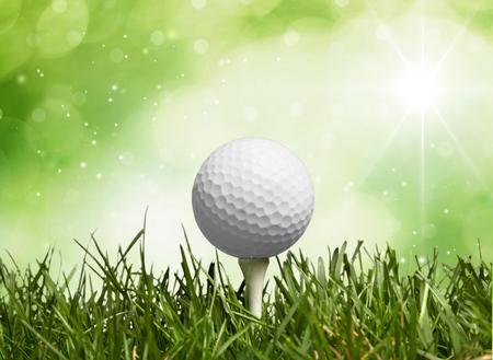 golf ball on tee: Golf.