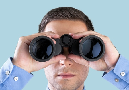 person looking: Binoculars. Stock Photo