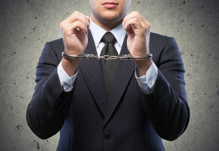 business suit: Handcuffs.