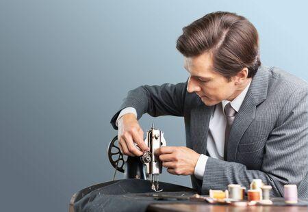tailor shop: Tailor.