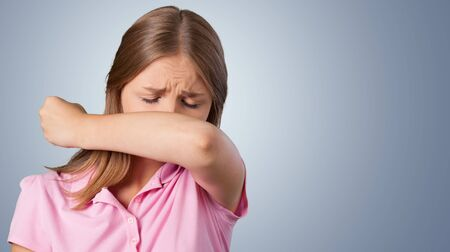 elbow sleeve: Coughing. Stock Photo