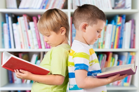kid reading: Reading. Stock Photo