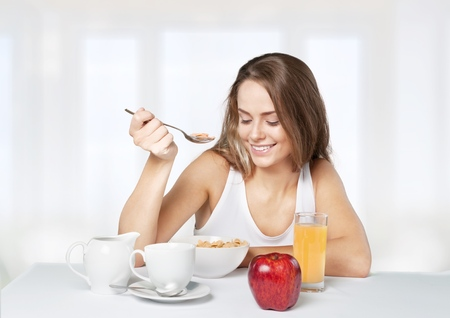 woman eating fruit: Healthy Eating.