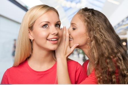 whispering: Whispering. Stock Photo