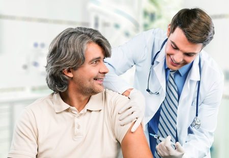 flu vaccinations: Injecting. Stock Photo