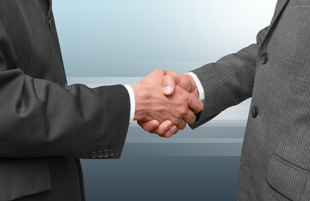 merging together: Handshake. Stock Photo