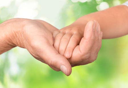 baby in hands: Human Hand.