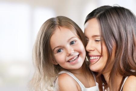 kid smiling: Mum.